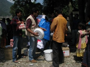 JayPrakash Panwar, a life member of Indian Red Cross Society distributing relief material to the families of Gyansu