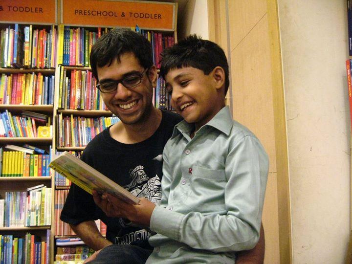 Why did Anoop move from the Plush Room of an Ohio College to the Dusty School Room of a Mumbai Slum?