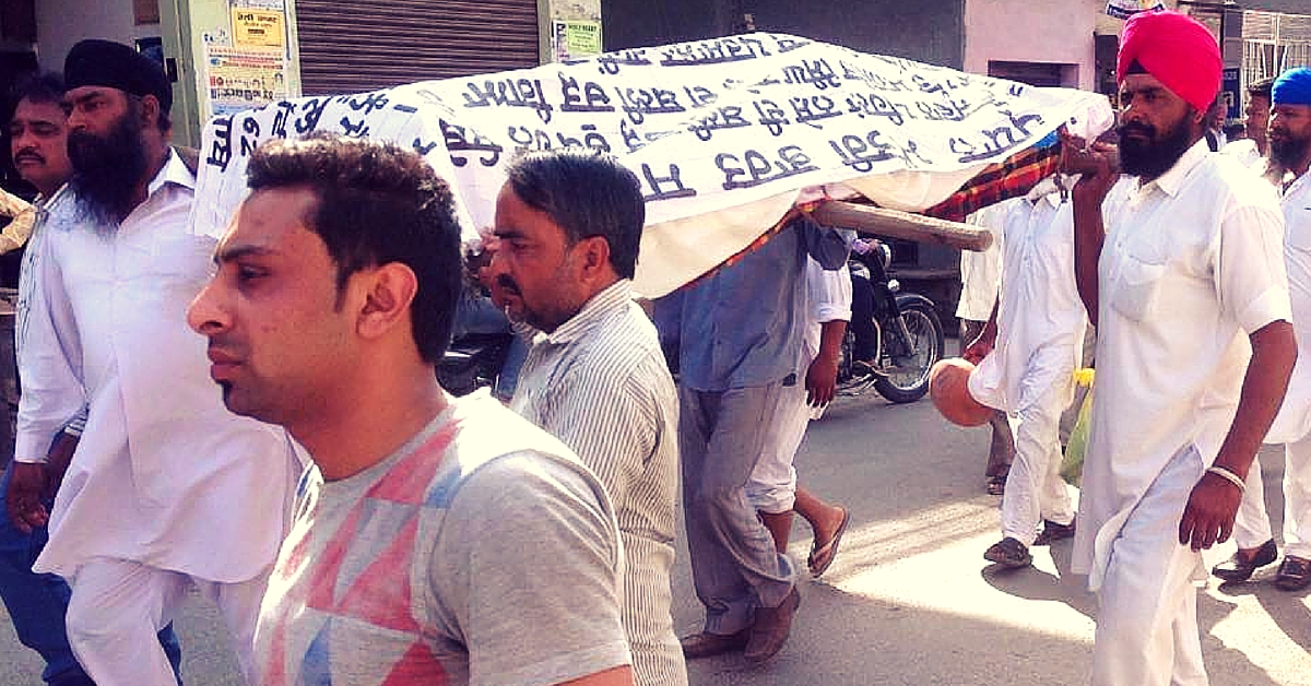 Draped in a Shroud That Covered His Son's Body, a Father Is Protesting against Drugs in Punjab