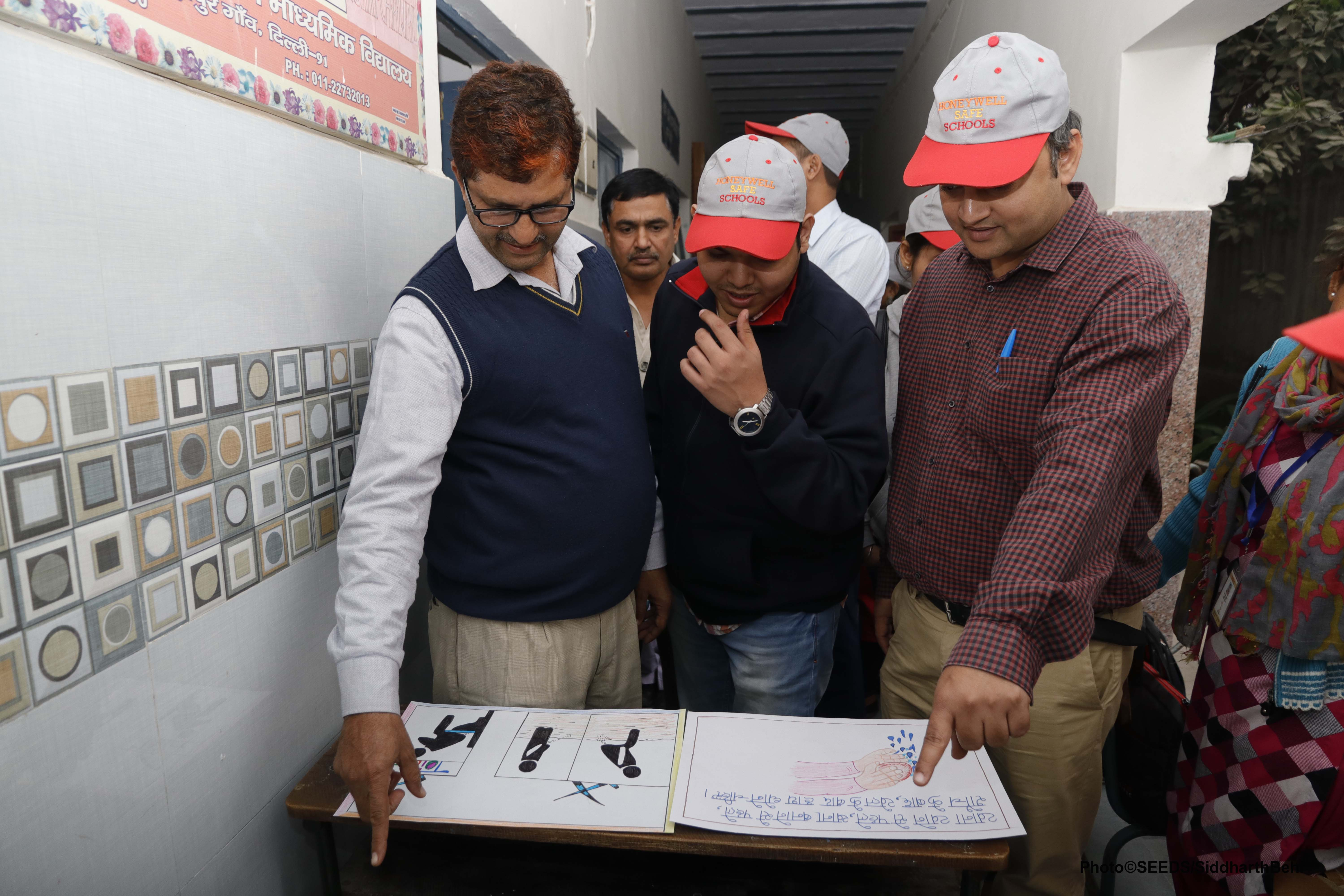 Experts and volunteers from SEEDS detailing safety measures to teachers in a government school. (Source: SEEDS)