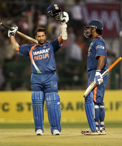Sachin Tendulkar raising his bat after reaching that milestone. (Source: Facebook)