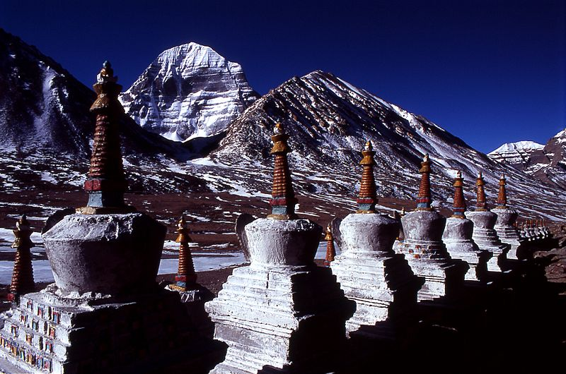 Buddhist Chortens with Mount Kailash in the background (Source: Wikimedia Commons)