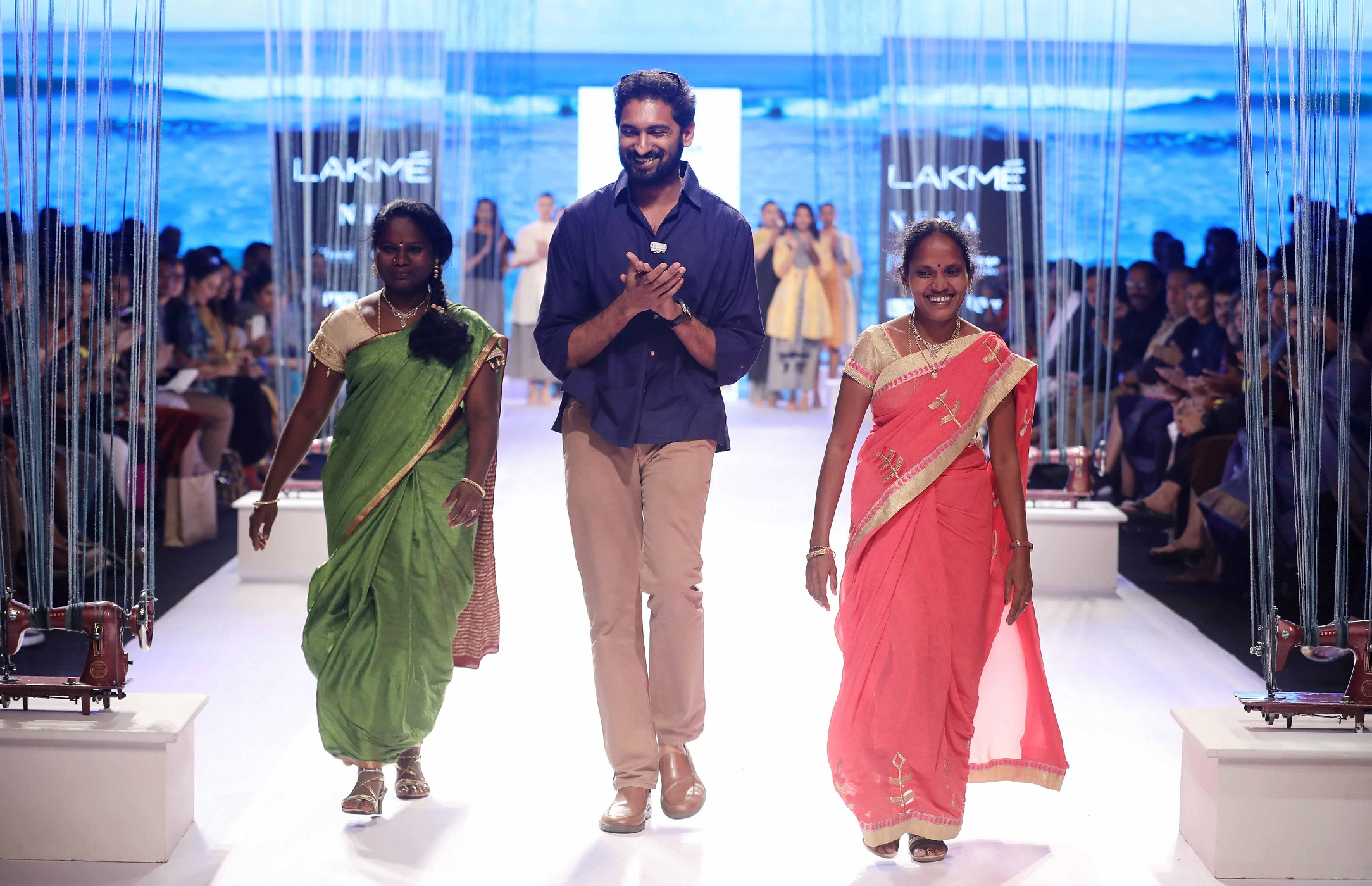 Two rural women from the Usha Silai centres on the ramp at Lakme Fashion Week. (Source: Usha International)