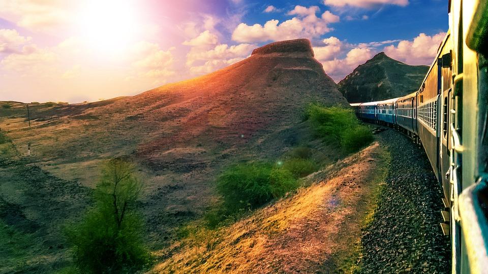 Rails running around hills and through mountains