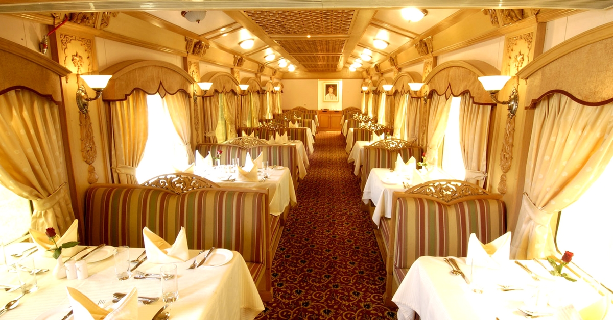 Dig into flavourful cuisine in an opulent setting on this luxury train. Image Courtesy: The Deccan Odyssey.