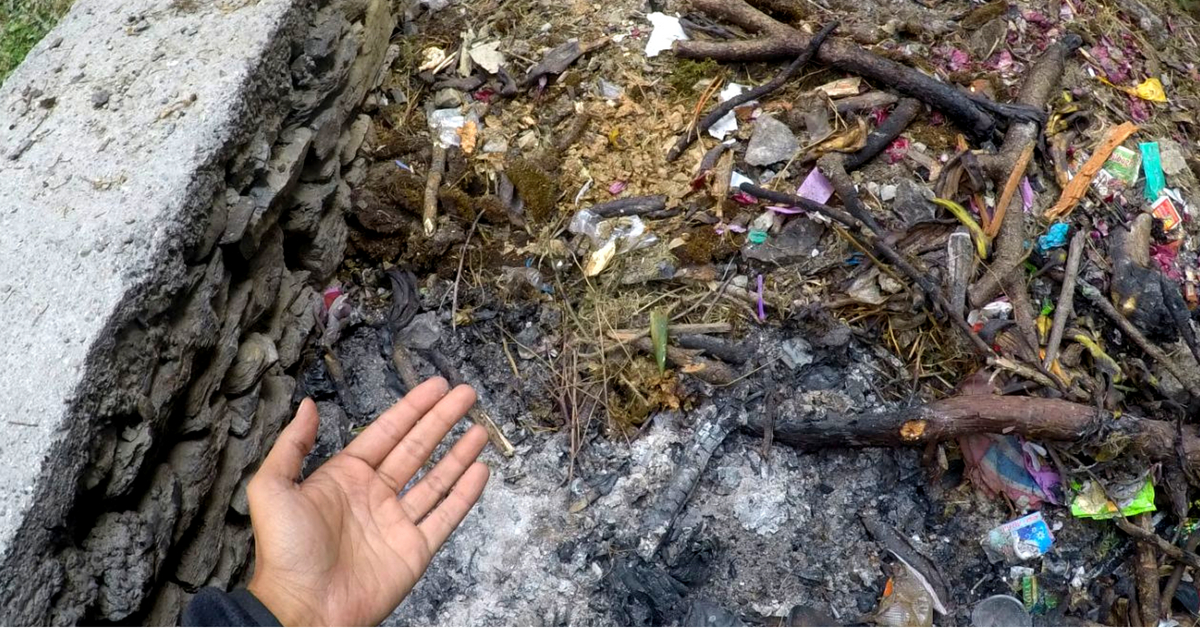 Emptying the pit, and segregating the waste was important, and the hikers got involved with the local population to do so. Image Credit: India Hikes