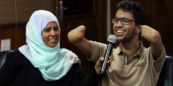 Islam Hussein with his mother. (Source: Facebook)