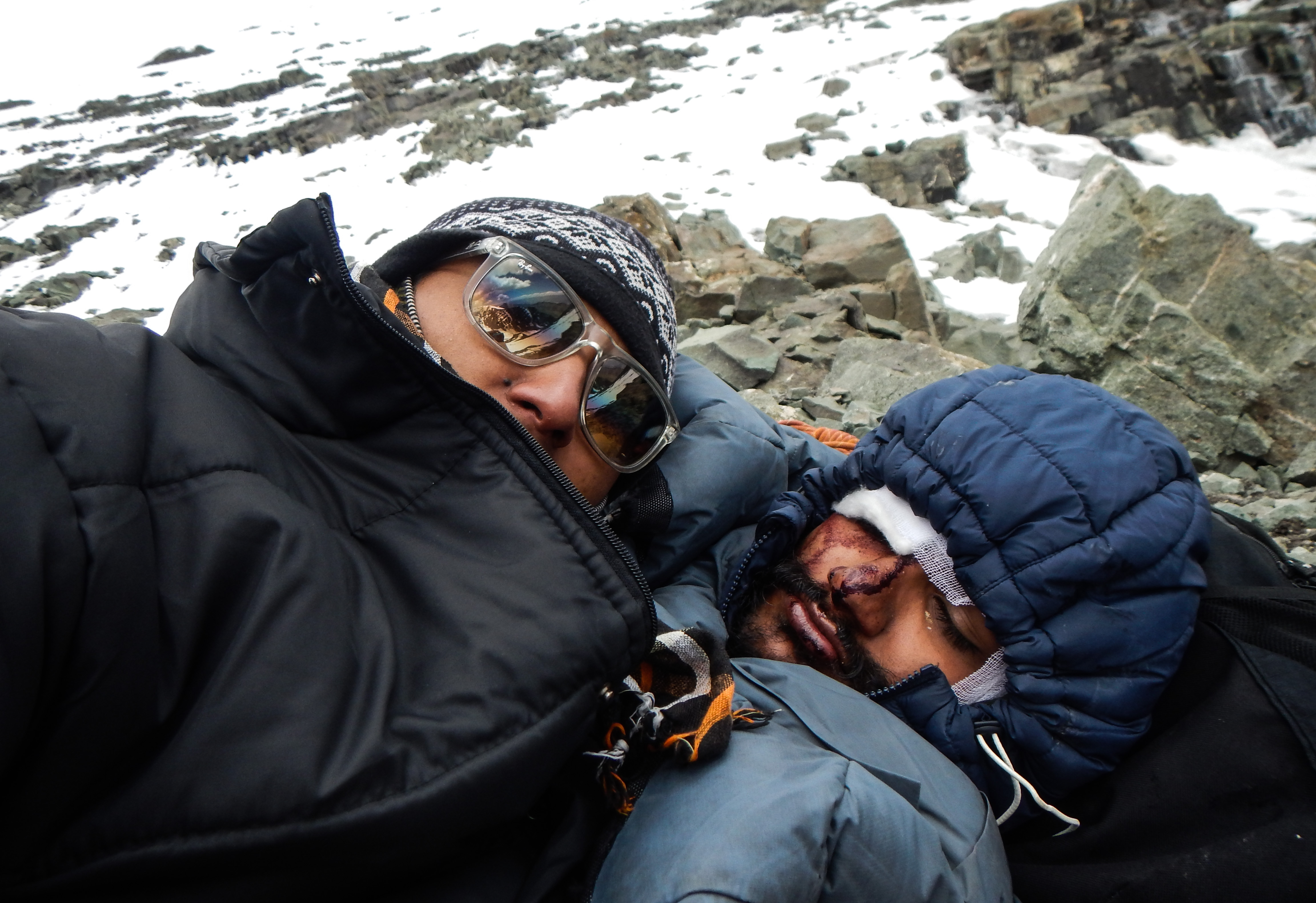 Bidhan (Left) with an injured Udesh while they were waiting for the rescue team. (Source: Bidhan Shrestha)