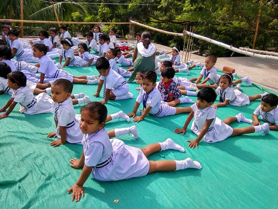 Students performing yoga. (Source: IPSRI)