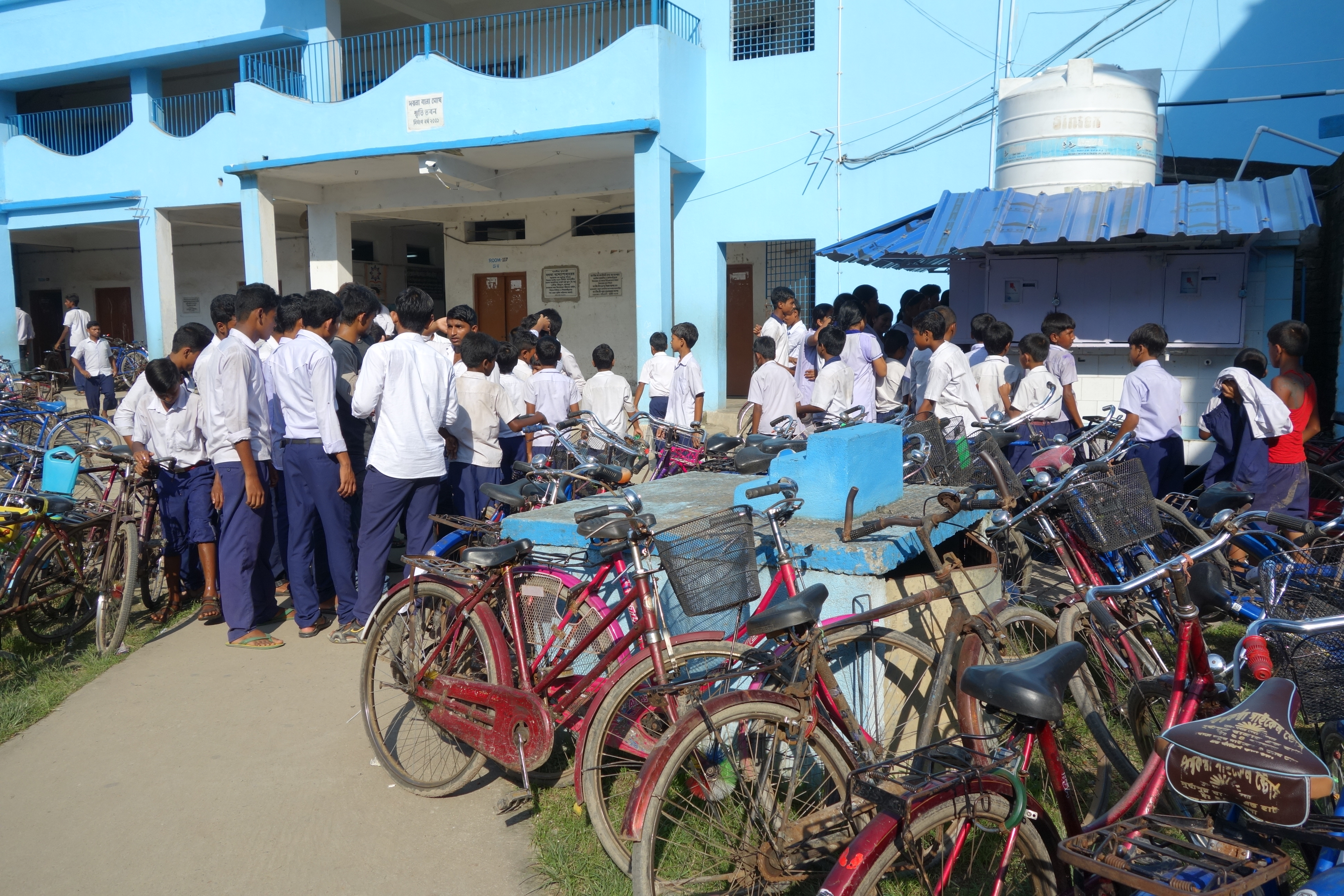 Water distribution to students of Dhapdhapi high school.