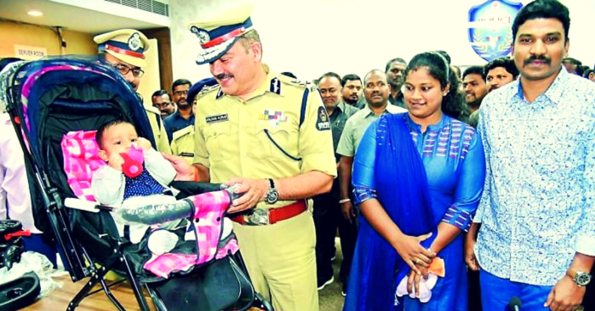Priyanka (in Blue) looking over a senior police official at the two-month-old child. (Source: My Medical Mantra)