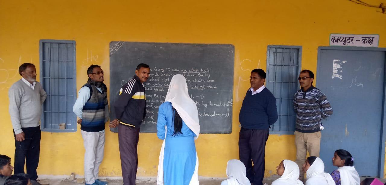 School monitoring visit: Officials on a random inspection.