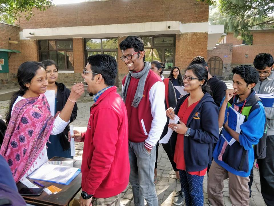 During a donor registration drive. Administering a simple cheek swab. (For representational purposes only.)