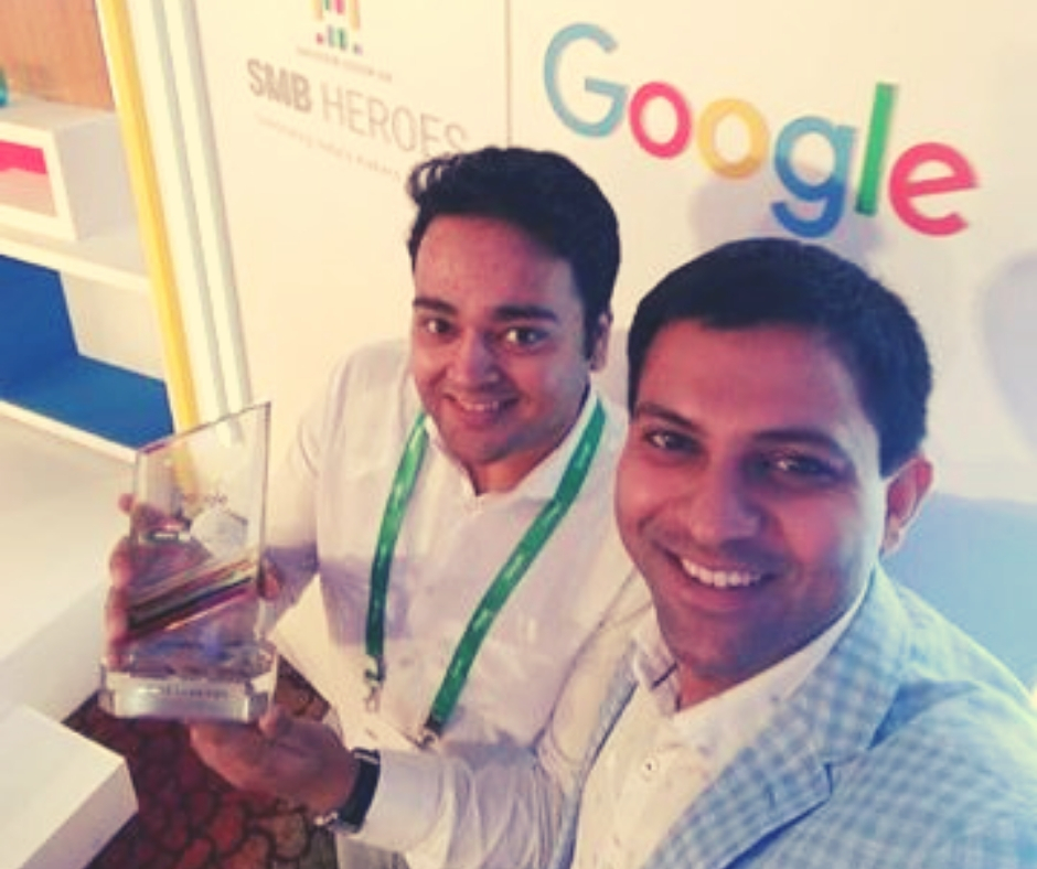 With their award from Google India.