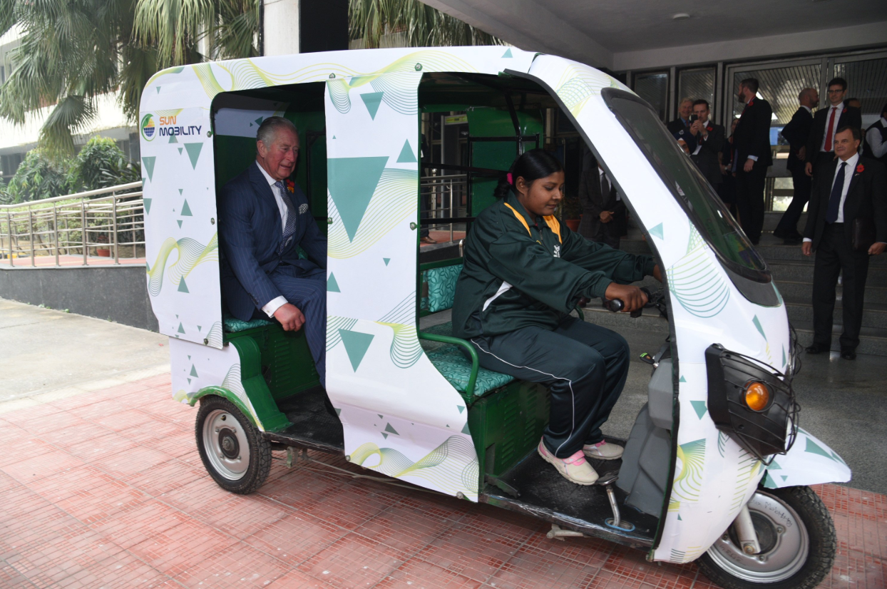 The Prince of Wales takes a ride on an e-rickshaw powered by SUN Mobility's smart batteries. (Source: Twitter/SUN Mobility)
